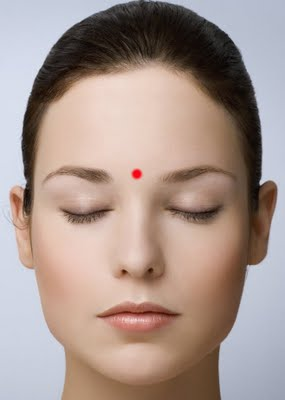 one of many points along your forehead is a point where the bridge of your nose joins the ridge of your eyebrows stimulating this point will offer relief