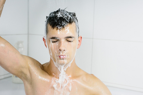 guy washing hair